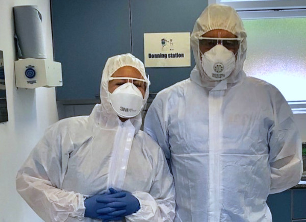 Dr Weller and colleague wearing PPE
