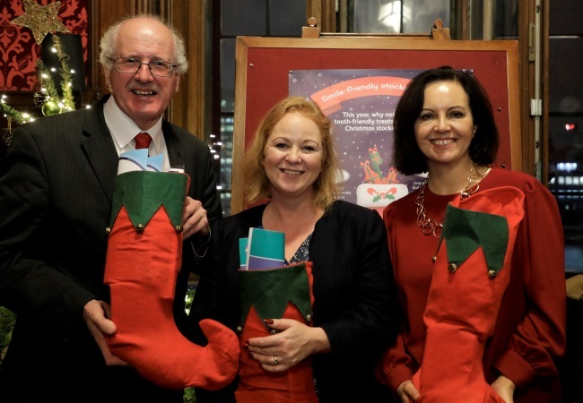 Jim Shannon MP, Judith Cummins MP, and Caroline Flint MP receive 'smile-friendly' Christmas stockings
